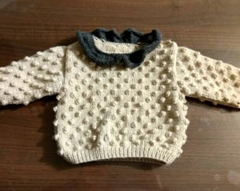 two-tone beige and grey sweater