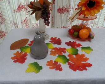 set of orange or green colored leaves ideal for a fall theme