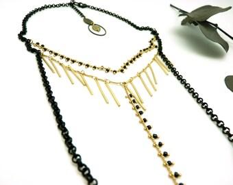 Collier long or mat et noir chic multi-chaînes collier Y CALLIPYGE
