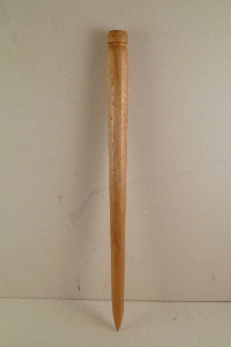 This hair stick has been turned with pcm3 Birch wood