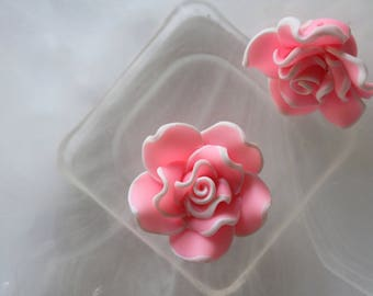 Pink and white polymer flower bead