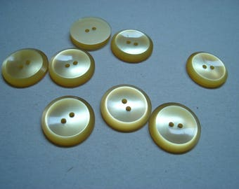 beveled yellow cast buttons