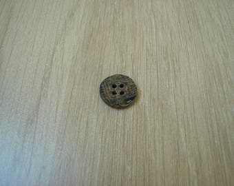 Brown and beige Horn button
