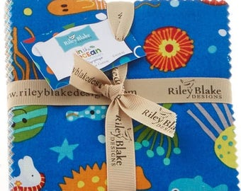 Charm pack set of Riley Blake patchwork fabrics in the ocean