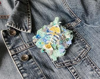 BROOCH textile art, predominantly aqua blue, mixing of threads, fabrics, creation JoeLesBiscottos