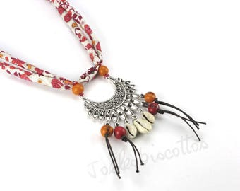 Fabric necklace ethnic style in orange with shells and metal centerpiece