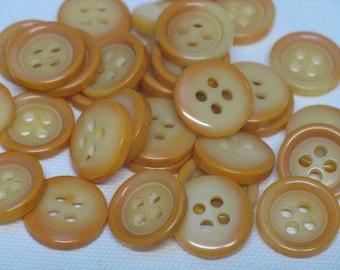 Set of 33 buttons, 2 yellow/orange tones, 18 mm in diameter
