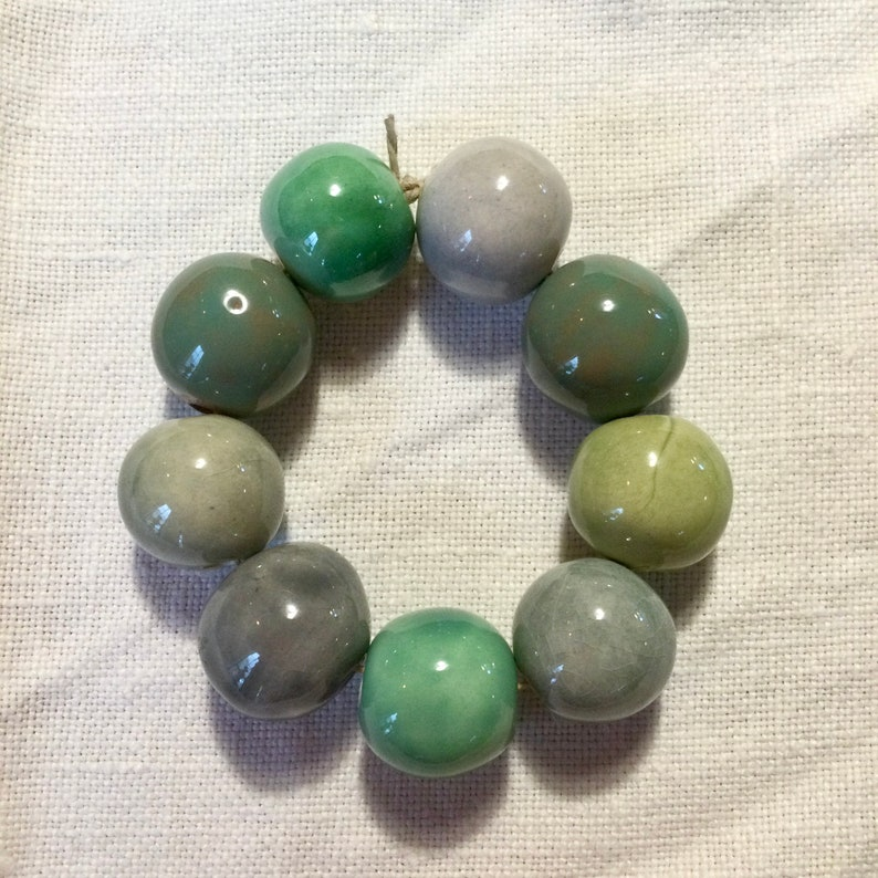 green and grey round handcrafted ceramic beads