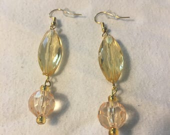 Yellow and silver drop earrings.