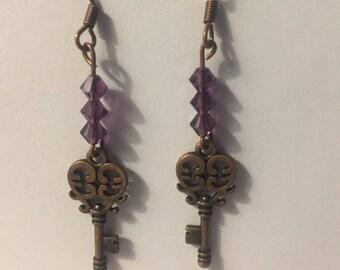 Skeleton key earrings with purple Swarovski crystals.