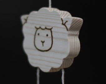 Baby gym toys. Wooden sheep.