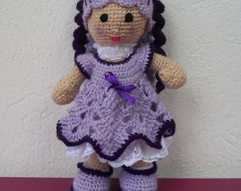 Purple crocheted wool doll