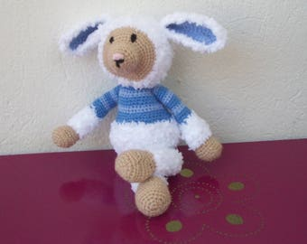 crocheted blue and white wool sheep