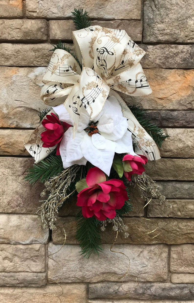 Golden Music Notes Holiday Swag-Red Christmas Swag-Cranberry Lotus Blossoms-Gold Ting Tings-Antique Gold Music Note Ribbon-White Poinsettia