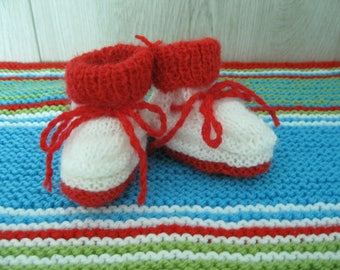 baby red and white with cord