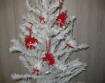 six Christmas ornaments hanging in wool
