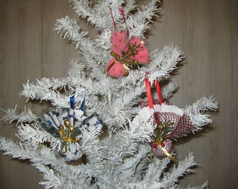 Three Christmas baubles in fabric decoration to hang