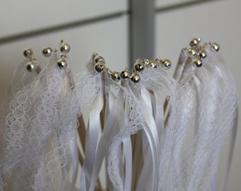 20 sticks, 2 white ribbons, lace and Bell (Bell)