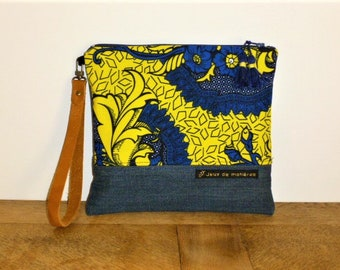 """""""Blue and yellow wax"""" hand bag made from African fabric, recycled blue jeans, brown leather strap, tassels."""