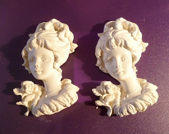 White plaster paint busts of women has the pink 2 piece