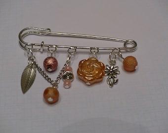 Brooch with dangle Orange
