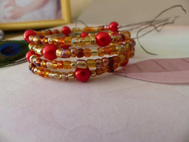 Red beads and golden brown shape memory bracelet