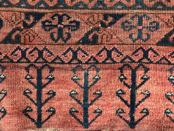 "Antique Turkmen Ensi rug. Wonderful wear and time softened vegetable dyes. 5'6"" x 4' 8"". Wonderful tribal pattern.  Brick red, teal, blue."