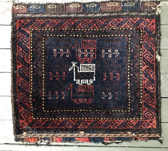 Wonderful Antique hand knotted bag face. Rug, wall art, orange, blue purple and white, 2x2 100% fine soft wool.