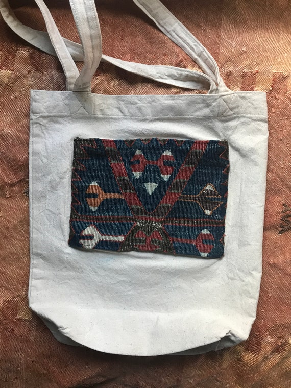 "Antique Kilim tote bag. 15"" high x 14"" wide with square bottom. Heavy canvas with Antique Kilim decoration"