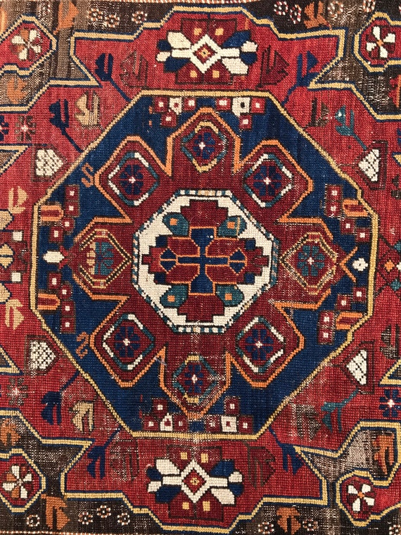 Antique Caucasian Kazak, Pre 1900 collectible piece . Beautiful design and organic colors, in great shape for it's age. 6ft x 3ft 1 in.