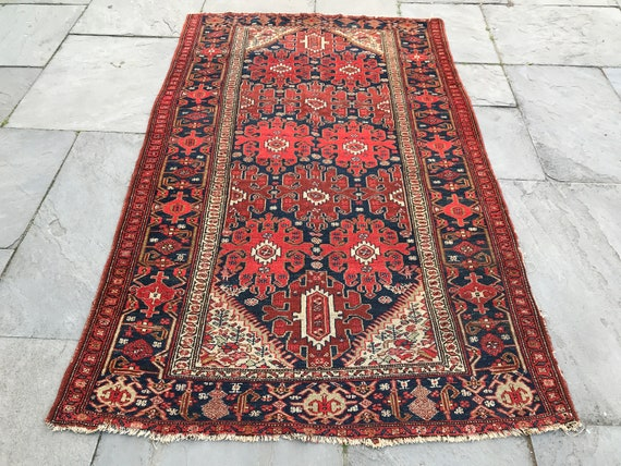 Vintage rug 5 x 7, blue and red with areas of olive green and lavender, early 20th century, this antique has small figures and fine knots