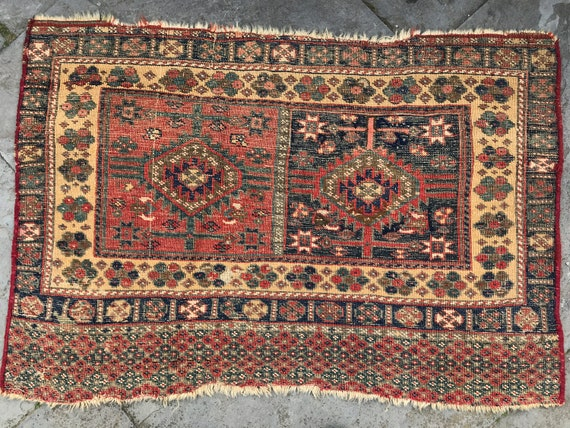 """Antique rug c 1870, Caucasian or Kurdish fragment of Camel bag, evenly worn, approximately 42"""" x 29"""", all hand knotted."""