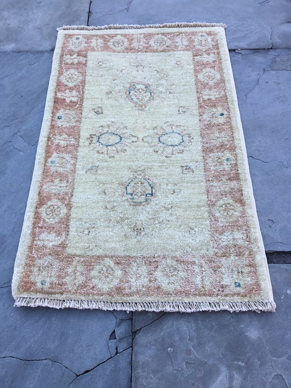 Vintage Turkish rug with soft pile, vegetable dyed wool and silk on a cotton foundation. 1 1/2 ft x 2 1/2 ft. Lovely soft faded colors.