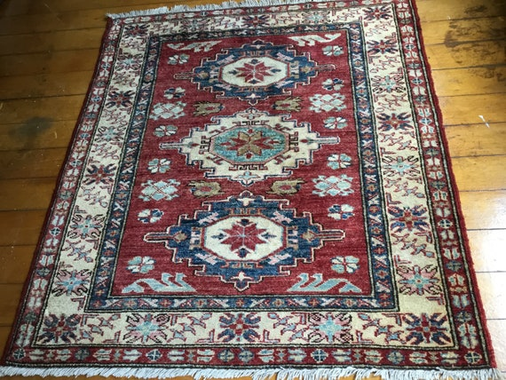 "Vintage Caucasian Kazak, fine soft wool and colors, tightly hand knotted wool on cotton foundation.low even pile, 33"" x 37"". Small Beauty."