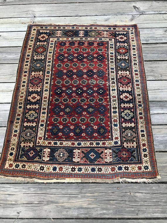 Antique Caucasian Kuba rug. Excellent condition, extremely finely knotted, soft wool and beautiful vegetable dyes 3' x  5