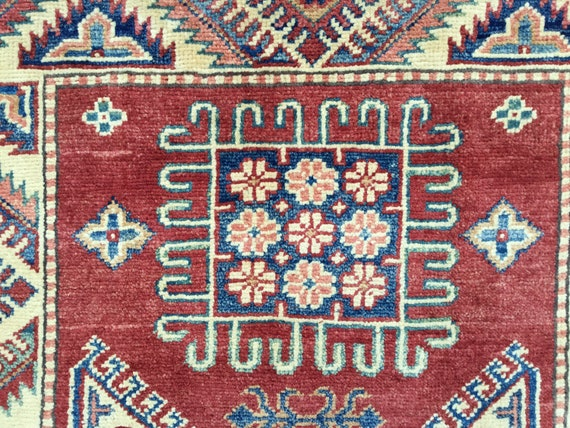 On Sale! Afghani.Kazak. wool rug. Beautiful vegetable dyed colors.  Very little wear. Nice gentle fading and abrash 3x5 vintage Kazak.
