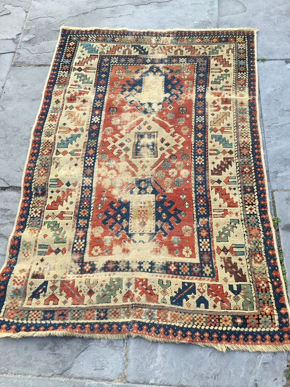 Antique Caucasian rug. Worn and wonderful c1880 Shirvan Azerbaijan rug.  sides and ends ingood shape. Hand knotted wool. Gorgeous colors