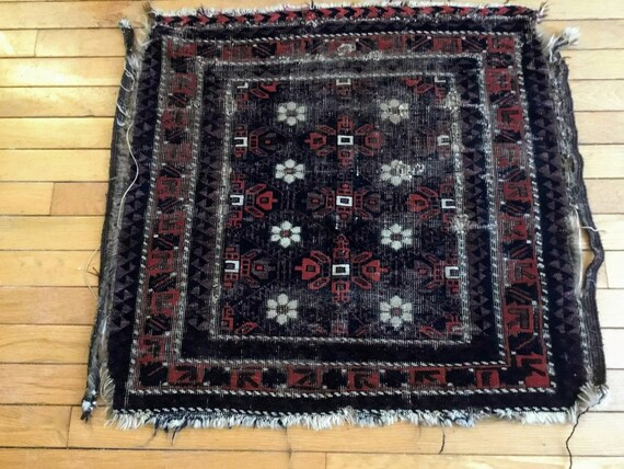 "Gorgeous, very old tribal Baluch. Small and worn. Fantastic colors, oxidized purple, blue and orange 28""x 29"". Collector's piece, untouched."