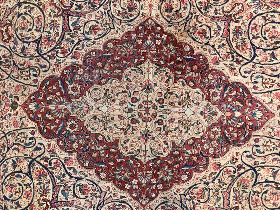 Very fine hand knotted Antique room size rug 9' x 12'. Reds, pinks, blues, natural wool, ( ivory) All hand knotted vegetable dyed wool.