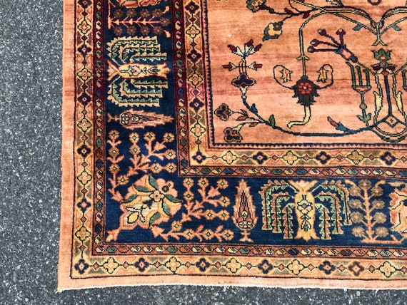 Antique Rug, Oversized rug, 10 x 13  Overall Peach color with dark blue border. Stylized trees, vines, Rare c1900 Sarouk, pastel orange/pink