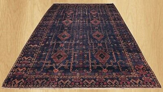 SOLD Vintage blue 7 x 10 rug. Distressed Navy blue hand knotted rug. Wonderful trial rug, all vegetable dyes. All hand knotted wool SOLD