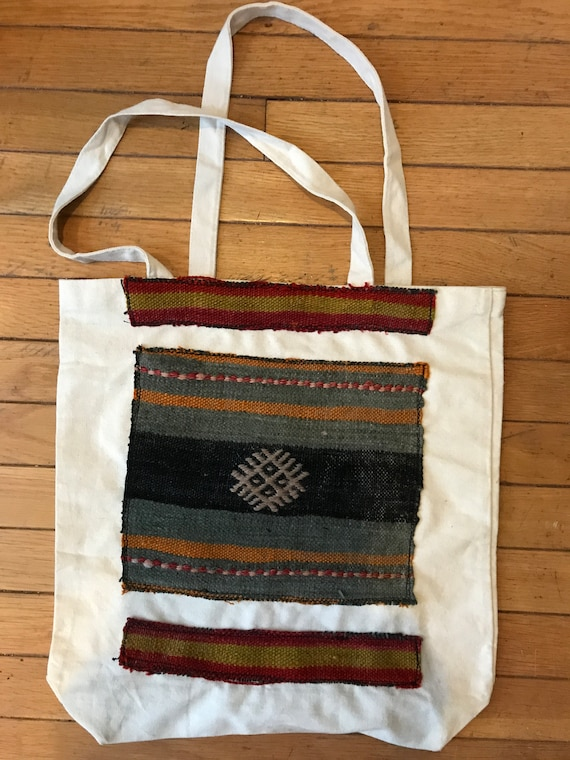 "Square bottom Vintage Kilim bags. Medium. Decorated on one side, heavy canvas, washable.wonderful faded Vintage Kilim colors. 15"" x 15"""