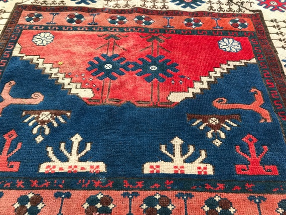 Vintage Turkish rug, distressed rug, Tribal motifs, beautiful wear and fading 4' x 5' vintage area rug. Wonderful colors and motifs.