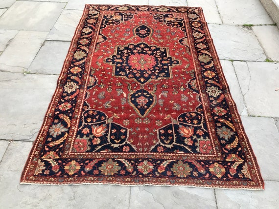 "Vintage 4 x 7 rug. 19th century Sarouk rug in excellent condition. Wonderful drawing and organic colors, 7'11"" x 4'3""  Low even pile."