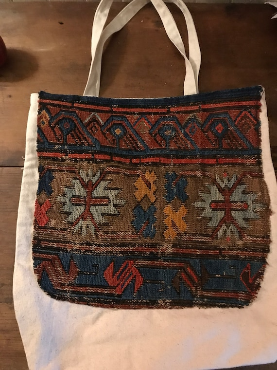 """SOLD. Tote bag. Caucasian Sumak Kilim carry all. Hand made with heavy cotton canvas and a large Antique Sumac Kilim remnant. 16"""" x16"""" SOLD"""