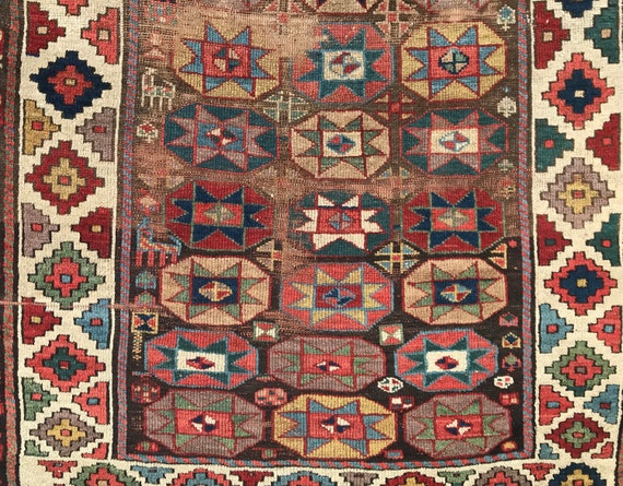 Rare Antique (ca.1850) hand knotted village runner. Distressed, 4 x 8 Kurdish tribal rug. Distressed carpet with beautiful vegetable dyes