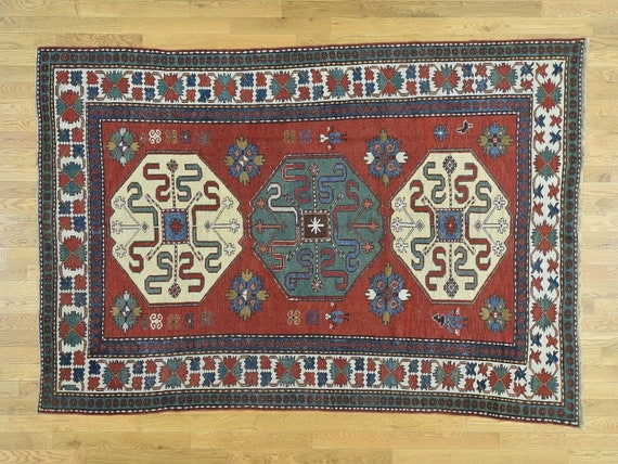 Early Caucasian Kazak, c1890. Museum quality.All vegeatable dyed wool, hand knotted, finest antique quality Cauasian rug. Highly collectible