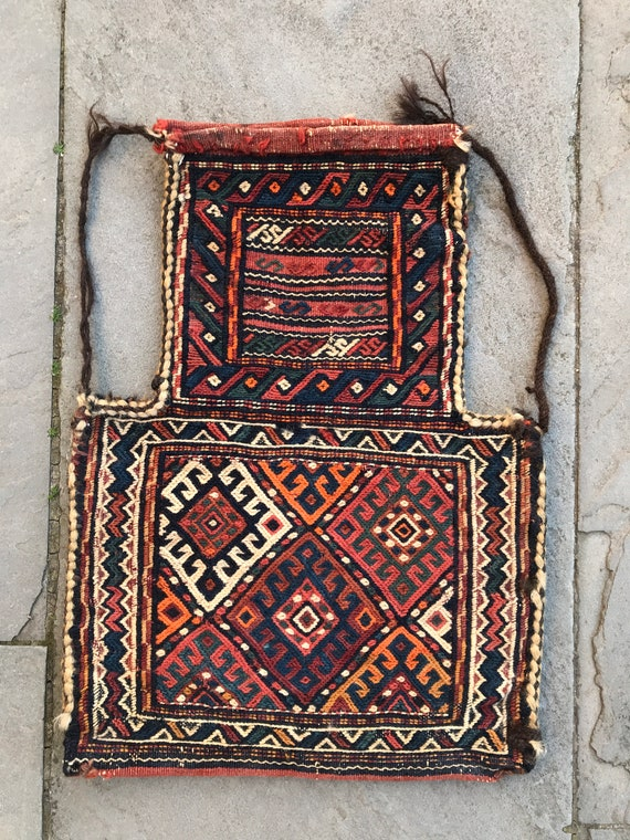 "Small hand knotted camel bag. Complete, no holes. Flat weave Sumak front and Kilim back. Nice collectible piece, 19th century, 22"" x 15.5"""