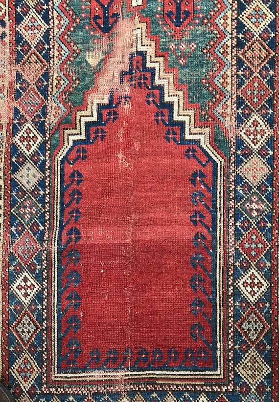 Vintage Turkish rug.  ca 1790 hand knotted wool Turkish Mudjar prayer rug, 6 ft x 3.5 ft. Worn. Gorgeous vegetable dyes, lavender, greens.