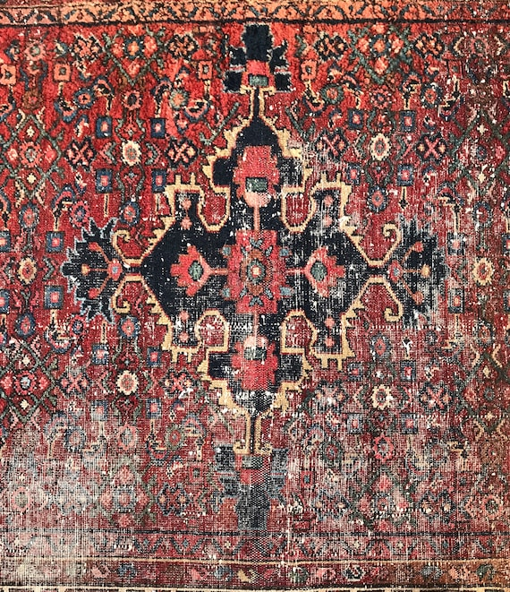"""Antique tribal rug, distressed antique, center medallion, corners and borders have birds and """"botch""""  all over wear,"""